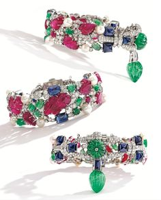 Three examples of Cartier's famous 'Tutti Frutti' Collection:  PLATINUM, CARVED COLORED STONE (rubies, emeralds and sapphires), DIAMOND AND PEARL Bracelets.