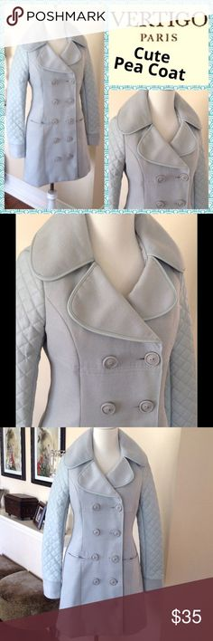 """VERTIGO Paris soft blue pea coat This pretty little pea coat is in a muted baby blue with faux leather quilted sleeves & collar trim. Double breasted button down w/ horizontal front pockets. Fully lined. Good condition w/ plenty of life still in it. Worn about 6 times, straight from the dry cleaner to you. 80%poly/18%rayon/2% spandex. Sleeves are like a pleather material. Approx measurements laying flat: shoulder to shoulder: 15""""/armpit to armpit:18""""/waist: 16""""/hips: 20""""/shoulder to hem:32…"""