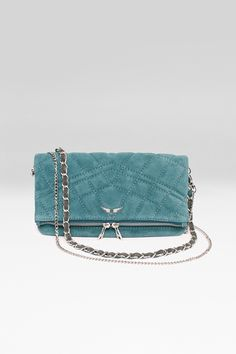 Zadig et Voltaire iconic quilted clutch, in suede, zipper with double slider, rectangular format that folds, two removable chains of different lengths composed by metal interlaced with leather, interior patch pocket and welt pocket in the lining, large wings skull rivet on the front, depth 2cm, height 15cm, length 27cm, shoulder strap length 78cm and 124cm, 100% leather, twill cotton lining.