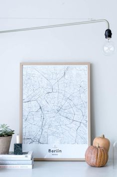 Berlin map poster by Mujumaps. Styled perfectly in a Scandinavian home with a minimal workspace.