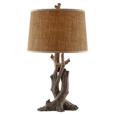 Earth-toned table lamp with a natural linen shade.  Product: LampConstruction Material: Resin, metal, and linen