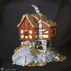 wow. What a cool and realistic looking MOC. love the rock its on, love the thatched roof, love the smoke coming from the chimney... by BrickNerd - Your place for LEGO news, reviews and the LEGO fan community