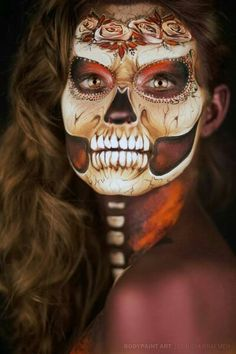Day of the dead - crazy makeup work! wow, so beautiful and yet creepy.