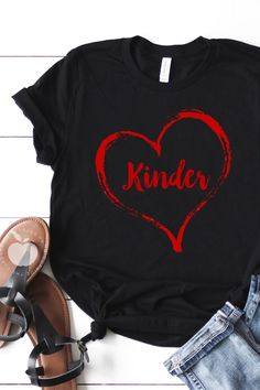 """Show how much you love teaching kindergarten with this subtle Valentine's Day teacher tee- perfect for January and February! This """"Love Kinder"""" tee is great whether you're looking for a new teacher t-shirt for your collection for any day of the year, or for Valentine's Day parties. This teacher tee is designed for kindergarten teachers and assistants."""