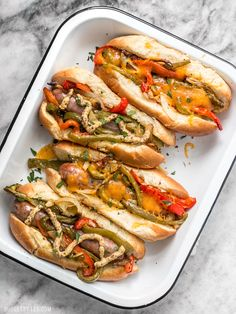 You don't need a grill to make these sweet and tangy Roasted Bratwurst with Peppers and Onions because the oven does all the work. BudgetBytes.com