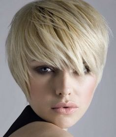 The lady in the image is having a short blonde hairstyle that is perfectly layered, short on the left side as compared to the other with a cute bang style. Description from shorthairstylesandcuts.com. I searched for this on bing.com/images