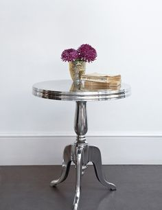 Modern side table in silver color looks good in hi-tech interior