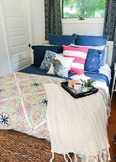 I have a friend who believes in only using white duvets and pillows when  decorating bedrooms. I'm warning you all right now, if you fall under this  category, you may need to pour yourself a glass of wine before continuing  to read this, because the amount of color and cheerfulness bursting out
