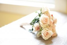 The mothers will carry small posies of blush spray roses wrapped in ivory ribbon with the stems showing.
