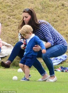 Kate laughed and joked around with George, at one point even teaching him how to kick a ball 14 June 2015