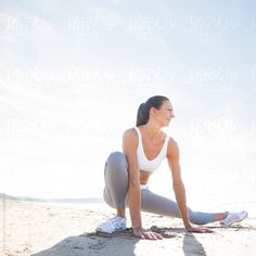Female fitness trainer on beach.  by Hugh Sitton for Stocksy United