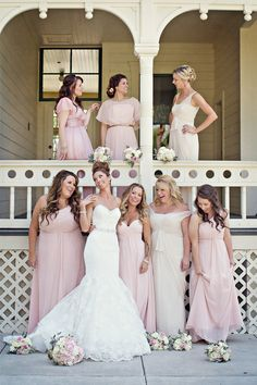 love the different shades of bridesmaids dresses. then the bridesmaids can choose a color and style that they feel most comfortable in. Love brides dress!!! ♡♡