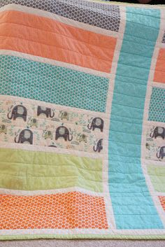 Easy Baby quilt - this is very cute! I think I could make cute lap quilts for our movie room recliners out of this pattern.