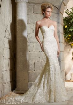 """Wedding Dresses and Wedding Gowns by Morilee featuring Alencon Lace on Net Over Soft Satin with Crystal Beading Featuring a feminine fit and flare silhouette, this gown combines Alencon lace over soft satin with just a touch of crystal beadwork. Available in Three Lengths: 55"""", 58"""", 61"""". Colors Available: White, Ivory, Light Gold"""