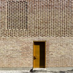 SHABOFFICE's latest villa in iran is wrapped with brick to create a unique expression