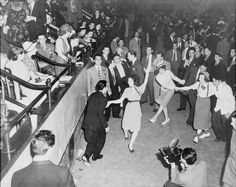 "Jitterbug dancers, 1938. The term ""jitterbug,"" derived originally from a slang term for alcoholics suffering the ""jitters,"" and popularized by Cab Calloway, described both the wild rhythmic energy of swing dancing and its dangerously addictive pleasures."
