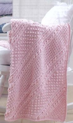 Gorgeous Baby's Diagonal Aran Afghan  |   4 different patterns: blackberries & crosses; moss stitch & cables; chevrons & diamonds; popcorn diamonds - CROCHET! Yea!