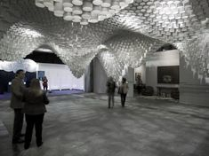 Cristina Parreño Architecture with MIT have created Paper Chandeliers, an installation for  the Art Fair ARCO in Madrid