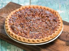 Utterly Deadly Southern Pecan Pie The secret to this rich pie is cooking the sugar and corn syrup first. It is definitely not diet food! I bake this pie for 45 minutes according to my oven but you may need to bake longer. Köstliche Desserts, Dessert Recipes, Southern Desserts, Pie Recipes, Cooking Recipes, Cooking Corn, Bakery Recipes, Recipies, Yummy Treats
