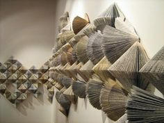 unconsumption:    Honolulu public library books that have been taken out of circulation get folded into art by Wendy Kawabata.   Pictured: Part of Wendy'sWithdrawn from Circulationinstallation in New Zealand.