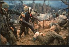 Jeremiah Purdie (center, with bandaged head) reaches toward a stricken comrade after a fierce firefight south of the DMZ, Vietnam, October (Larry Burrows—Time & Life Pictures/Getty Images) Laos, Sargento, Vietnam War Photos, Vietnam History, North Vietnam, War Photography, Iconic Photos, Rare Photos, Rare Images
