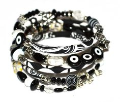 Black, white and silver adjustable wrap bracelet with glass and handmade fabric beads on memory wire