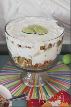 Key Lime Pie Trifle with crushed white chocolate macadamia nut cookies and homemade whipped cream.  Oh my goodness, this looks sooooo good!