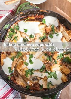 Baked Ranchero Eggs: Poached eggs in ranchero-black bean sauce with melted jack cheese, crispy tortilla strips, and lime sour cream. It's brunch life, baby! Vegetarian Mexican, Vegetarian Appetizers, Mexican Food Recipes, Dinner Recipes, Breakfast Nachos, Breakfast For Dinner, Sweet Potato Recipes, Poached Eggs, One Pot Meals