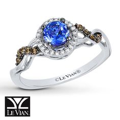 A round Blueberry Tanzanite® encircled by Vanilla Diamonds® forms the center of this elegant ring from Le Vian®. Waves of rich Chocolate Diamonds® intertwine with polished waves of 14K Vanilla Gold® to create the band. The ring has a total diamond weight of 1/6 carat.