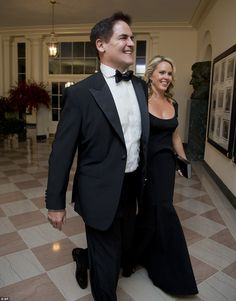 NBA's Dallas Maverick owner Mark Cuban and his wife Tiffany Cuban both arrived wearing black outfits for the State Dinner