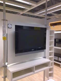 The versatile STOLMEN system at Ikea has always been a favorite. With all the different bits and pieces you can configure it to be a a room divider, closet, or entertainment unit. While visiting Ikea over the weekend I came across the STOLMEN system set up as a flat panel TV mount.
