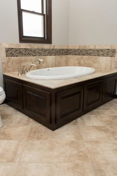 Beige Tile Tub Surround with Brown and Green Tile Accent Wall Bathroom Stone Wall, Bathtub Design, Beige Tile, Bathroom Remodel Designs, Tub Surround, Green Tile, Tile Accent Wall, Tile Tub Surround, Bathroom Wall Tile