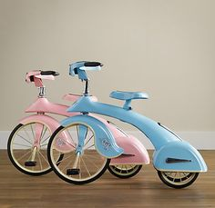 Baby blue and pastel pink replicas of a 1936 sky king tricycle-kid heaven