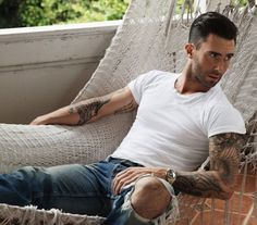 Adam Levine- men's hair cut. Short sides long on top.