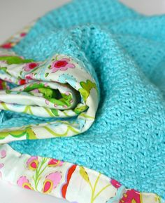 Another reversible baby blanket.  I like the mix of fabric and crochet- great idea for baby #2
