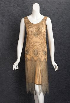 Beaded flapper evening dress, c.1925. The beaded embellishment combines ropes of iridescent crystal seed beads with silver beads and rhinestones.