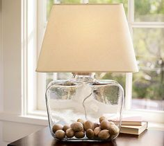 My favorite lamp of all time.  The opening is large enough to put all kinds of stuff in. Easy to change seasonally. Good sized base and weighted well so kids can't knock it over easily.