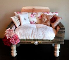 Another luxury doggie bed with distressed wood, fluffy cushion and decorative pillow. $950.00