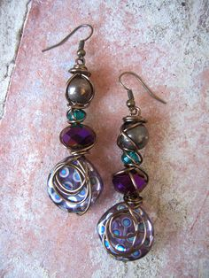 Glass and swirled wire earrings in purple and teal. $15.00, via Etsy.