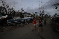 A police patrol boat lies marooned on top of debris in downtown Tacloban. It was carried into the city by the storm surge which destroyed th. Police Patrol, Storm Surge, Medical News, Red Cross, Boat, City, Boats, City Drawing, Cities