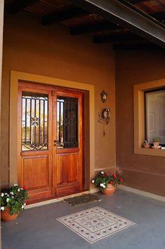 Puerta principal: Casas de estilo rústico por Abitar arquitectura