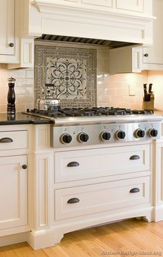 Simple clean field tiles with bold medallion detail above cooktop.