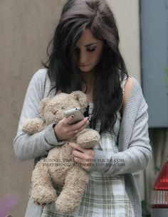 <3 Demi holding a teddy bear while texting.