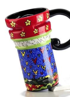 Romero Britto Hearts Travel Mug by romero brito. $29.99. 5.8x3.6x6.3. 14 oz. Ceramic, authentic dolomite, mug designed by Romero Brito. Boxed for giving. Each item is a work of practical work of art. The mug has a plastic top and a convenient handle. It comes with an anti-slip base so it won't slide. Perfect to cheer up your day! You will love it! Great as a gift!