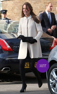he Duchess of Cambridge wore a chic alabaster white coat by Goat with cutesy collar, which masked any sign of a baby bump when visiting the offices of Child Bereavement UK. Underneath she sported a black Peter Pan-collared Topshop, and black gloves and a matching clutch added a monochrome edge to her snowy get-up.