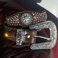 "Stunning Nocona Crystal Concho Leather Cowboy Belt -Stunning Designer Nacona Crystal and Brown Croc Leather Belt! Tons of vibrant and colorful bezel set crystals and large crystal conchos adorn this well-made leather belt - It also has silver tone studs and hardware - Big country style buckle and in GREAT ""pre-owned"" condition with no missing crystals (checked and double checked too) - Size Small (28-30) - Nocona Accessories Belts"