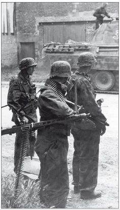 Waffen SS Grenadiers near a Panther from I./SS-Panzer Regiment 12, 25 June 1944.