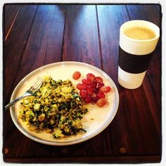 Breakfast today was eggs scrambled with coconut oil, onion, collard greens, and cumin with a handful of grapes and a bulletproof coffee…