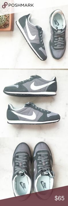 Nike Dark Gray with Light Mint Sneakers Combination nylon, mesh, and suede uppers.  Padded collar for comfort and support. Traditional lace-up closure ensures a secure fit.  Low profile midsole with pop color stripe.  Breathable textile lining and a padded footbed for all-day comfort. Durable rubber outsole for traction.  Iconic Nike Swoosh® logo at sides. Size US 7 EU 38 Photo 1, 2, 3 & 4 Dark gray with light mint green detailing Nike Shoes Sneakers