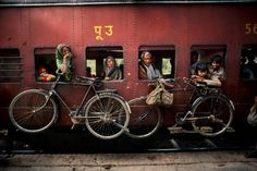 Bicycles hanging on the side of a train, West Bengal, India, Photographer: Steve McCurry Steve Mccurry, West Bengal, Smartphone Fotografie, Vivre A New York, World Press Photo, Composition Techniques, Afghan Girl, Digital Photography School, Photo Composition